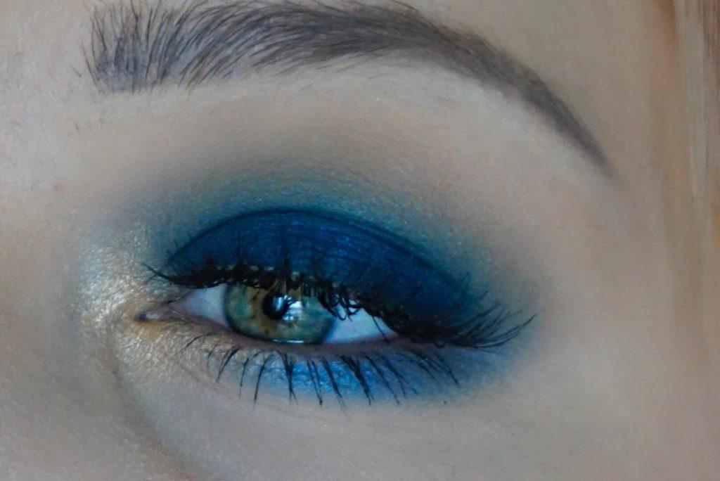Royal blå med guld och turkos