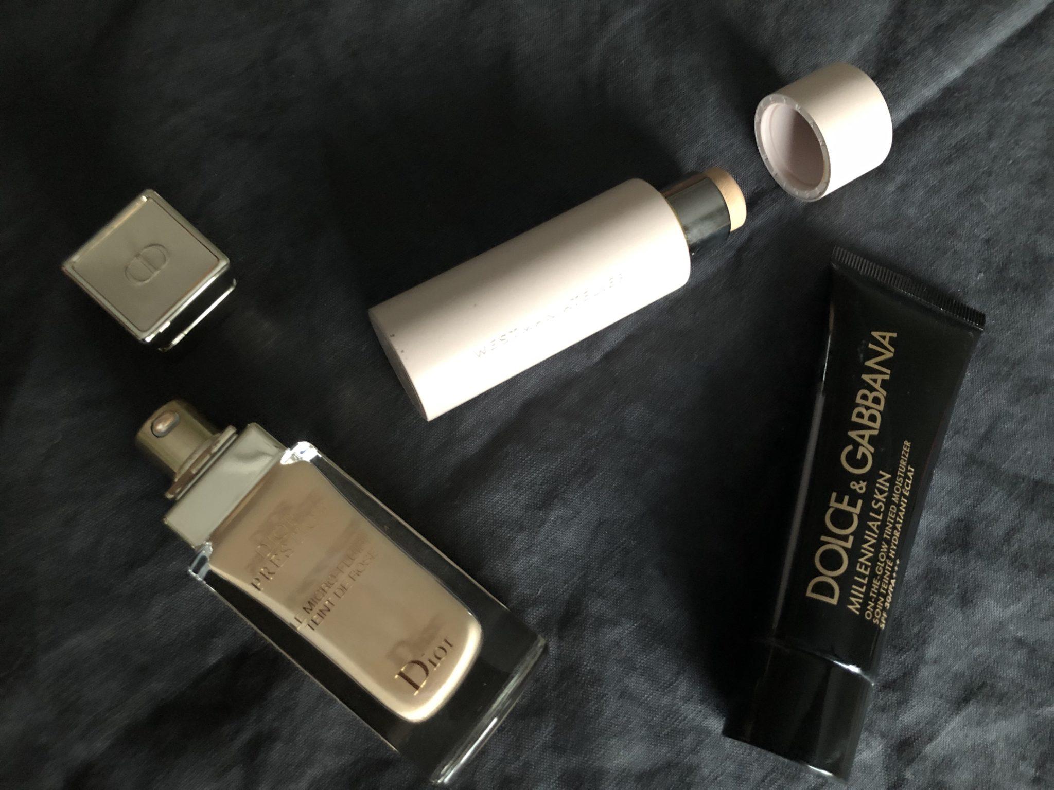 Bilden visar de tre foundations som nämns i texten: Westman Atelier Vital Skin Foundation Stick,Dolce & Gabbana Millennial Skin On-the Glow Tinted Moisturizer och Dior Prestige Le Micro-Fluide Teint de Rose Foundation.