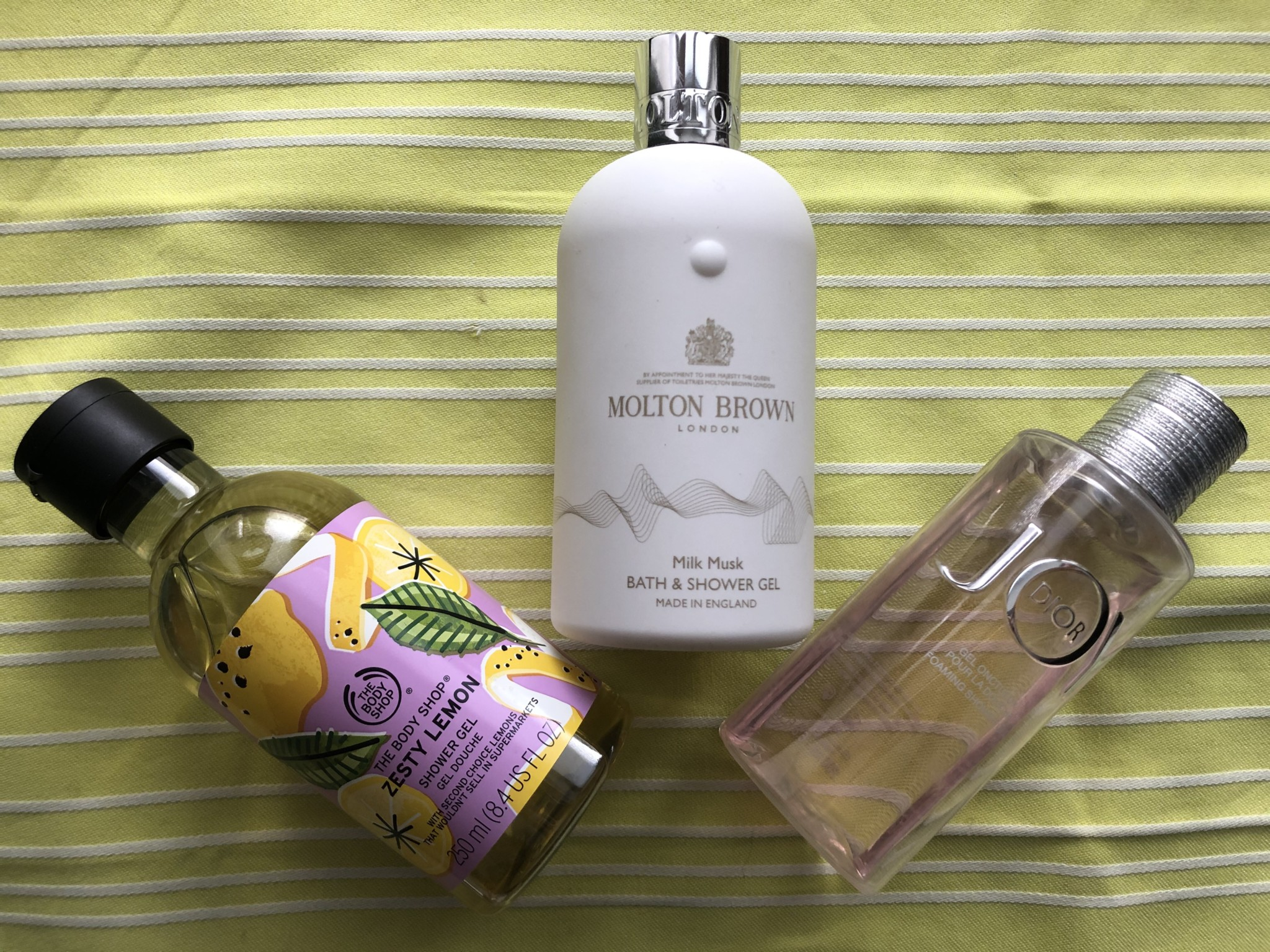 The Body Shop Zesty Lemon Shower Gel, Molton Brown Milk Musk Bath Shower Gel, Dior JOY Foaming Shower Gel.